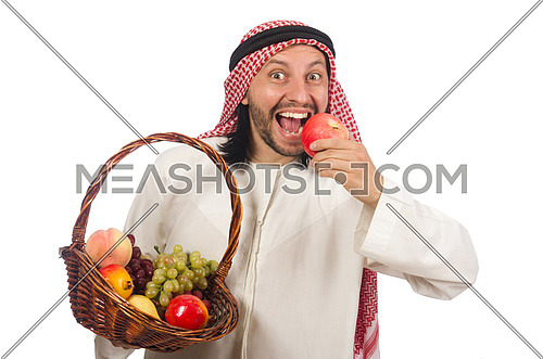 Arab man with fruits isolated on white