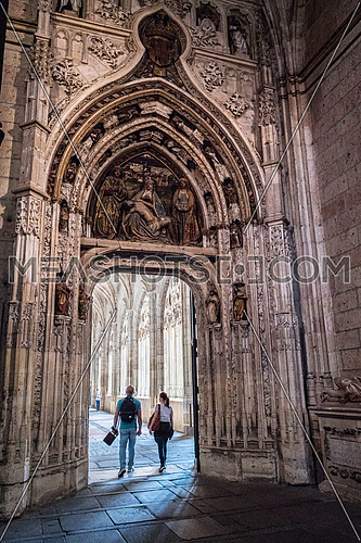 SEGOVIA, SPAIN, JUNE - 3, 2017: Interior of Cathedral of Our Lady of Assumption, Access door to the Cloister, Located on the south side of the cathedral, It is decorated with a set of piety or the Virgin of the Quinta Angustia, take in Segovia, Spain