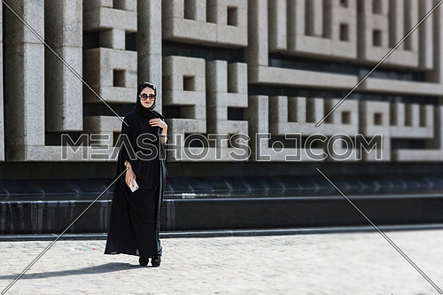 Saudi lady standing in front of famous square in Jeddah