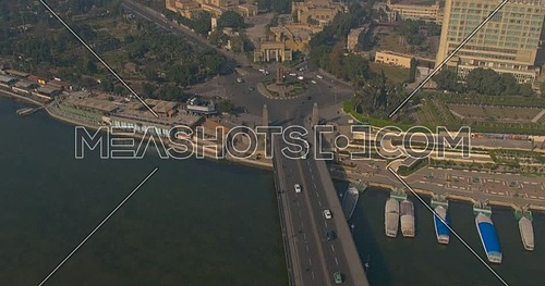 Drone Shot flying towards Cairo Opera House revealing Saad Zaghloul Statue showing Qasr Al Nile Bridge across the River Nile at early morning