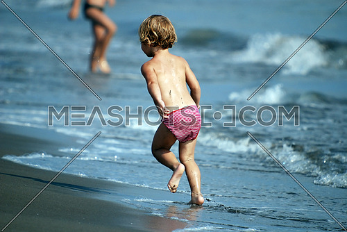 child running on beach