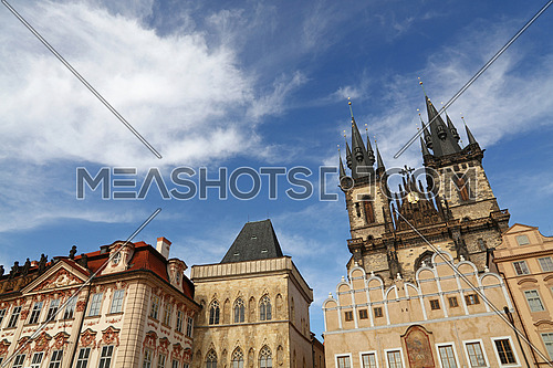 Low angle view of Old Town Square and Cathedral of Our Lady before Tyn over clear blue sky, Prague, Czech Republic