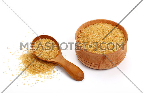 Wooden scoop spoon and bowl full of brown cane sugar with pinch of sugar spilled around isolated on white background