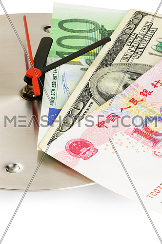 currency bills on a stainless steel clock clock on white back ground