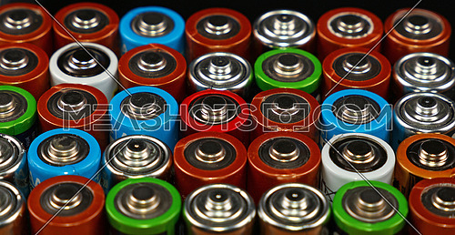 Close up background of assorted colorful electric alkaline batteries