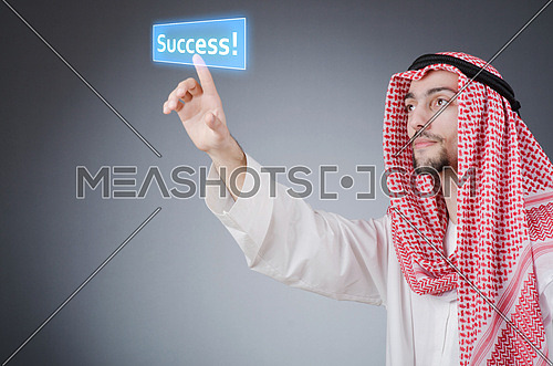 Young arab pressing virtual buttons