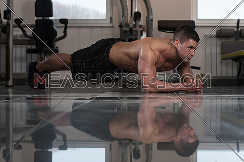 Healthy Young Man Exercising Abdominals On Foor
