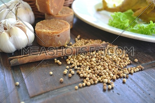 Coriander seeds and cinnamon on a wooden table, Indonesian spices and raw materials for food.