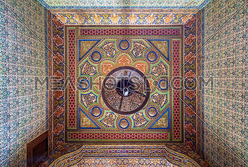 Royal era colorful engraved wooden ceiling with floral pattern decorations at historic Manial palace of Prince Mohammed Ali, Cairo, Egypt - open for public visits