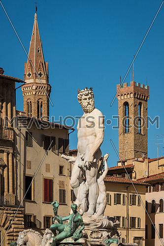 Statue of Neptune with towers in background, Piazza della Signoria, Florence (Italy)