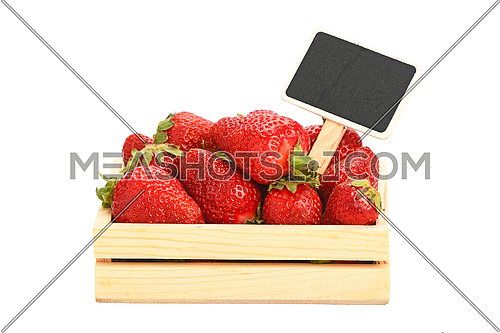 Mellow fresh red summer strawberries in wooden tray box with chalk blackboard price tag sign isolated on white background