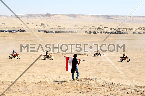 A child watching for a rally in the desert of Fayoum in the first annual desert festival 13 October 2017