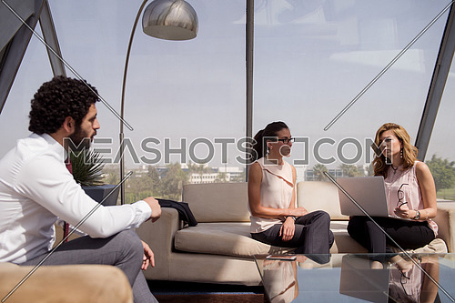 business people group on meeting at modern startup office interior