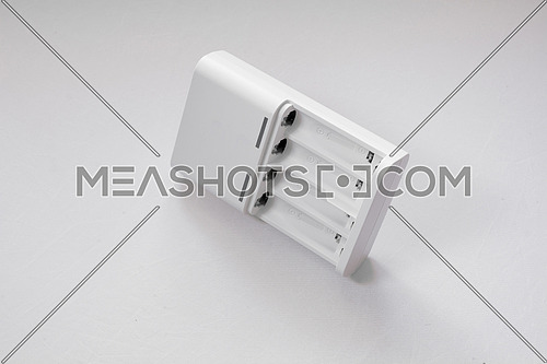 Quick  battery charger on white background