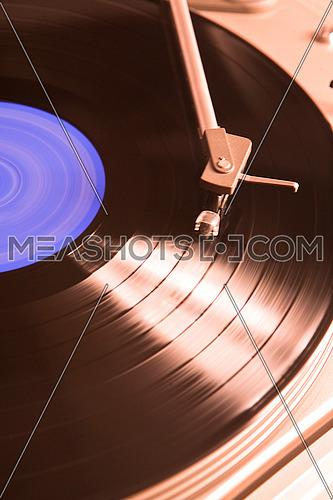 Spinning vinyl record, conceptual image