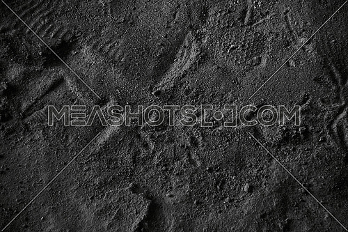 Top shot for floor with cement dirt and footprints monochrome.