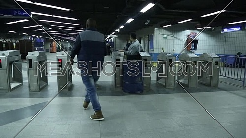 Fixed shot inside Metro Station for people walking to tickets machines at Cairo