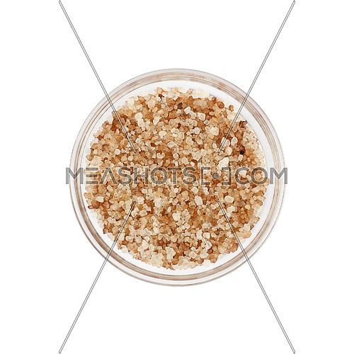 Close up one glass bowl saltcellar full of crystals brown smoked Danish salt isolated on white background, elevated top view, directly above