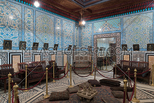 Manial Palace of Prince Mohammed Ali. The mirrors room at the residence building with Turkish floral blue pattern ceramic tiles wall and decorated wooden ceiling