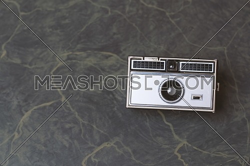 Retro classic 35mm photo camera on Background