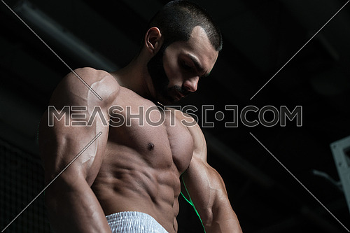 Portrait Of A Young Fit Man Showing His Well Trained Body - Muscular Athletic Bodybuilder Fitness Model Posing After Exercises