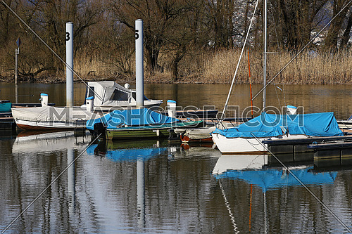 Boats docked in a small harbor on a waterway