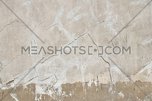 Background texture of old beige gray painted plaster wall with cracks and grunge repair stains