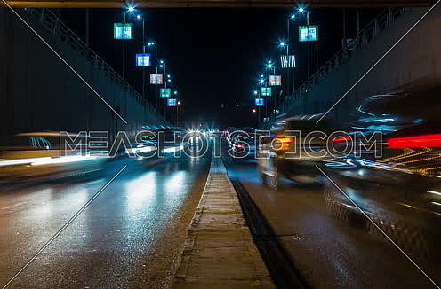 Zoom OUT Shot for traffic from inside  Al Thawra Tunnel at Night