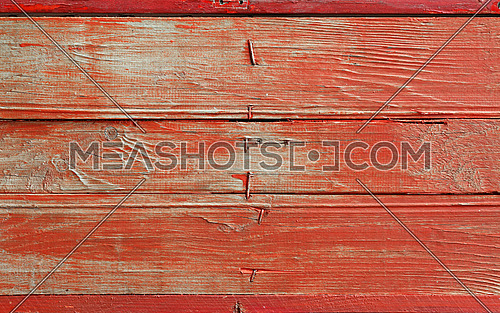 Red vintage grunge old painted wooden plank background texture with stains, brushed faded woodgrain and nails