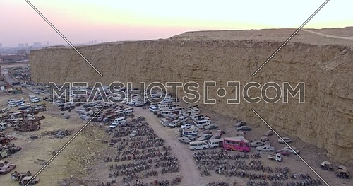 Fly over Shot for Wrecking yard till reveals the city of cairo at Day