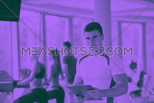 group portrait of healthy and fit young people in fitness gym duo tone