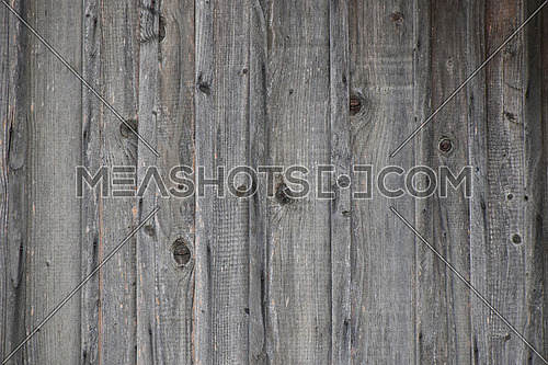Old dark vintage rustic aged antique wooden sepia fence panel with vertical gaps, planks and chinks