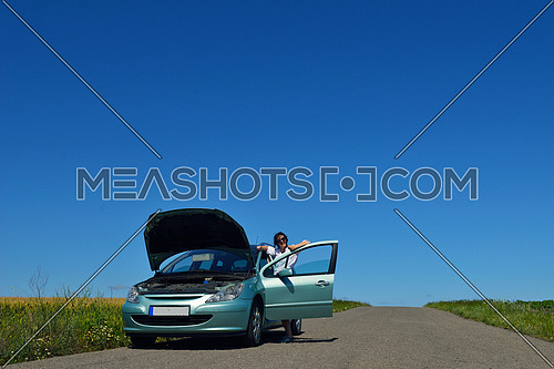 portrait of young beautiful woman with broken car