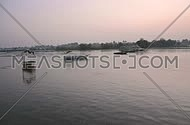 Beautiful Panoramic View For the Nile and boats in the sunrise at Alqanatir Al Khayriyah - Egypt