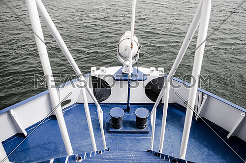 A front deck of a boat in light blue