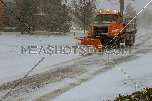 Clearing the road from street during snow blizzard