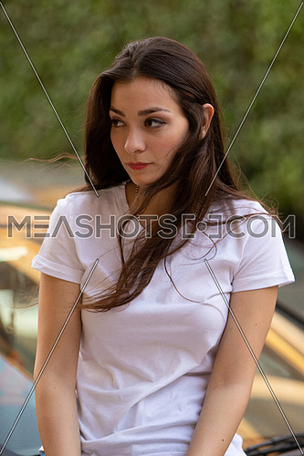Egyptian female portrait outdoor with long hair