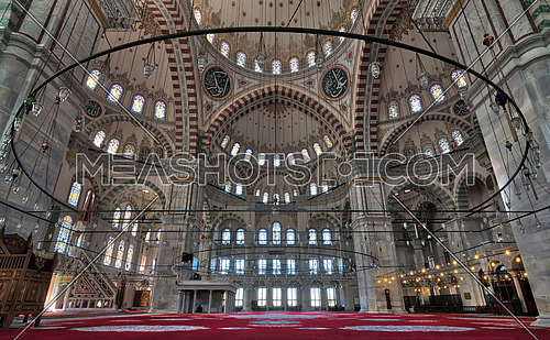 Fatih Mosque, a public Ottoman mosque in the Fatih district of Istanbul, Turkey, with a huge decorated domes & many colored stained glass windows