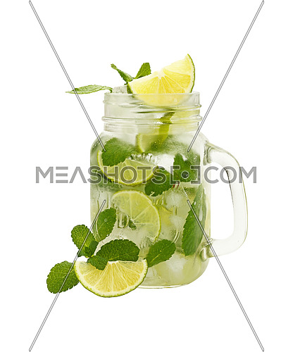 Close up one full, big mason jar glass of mojito with mint leaves, lime slices and ice cubes, isolated on white background, high angle side view