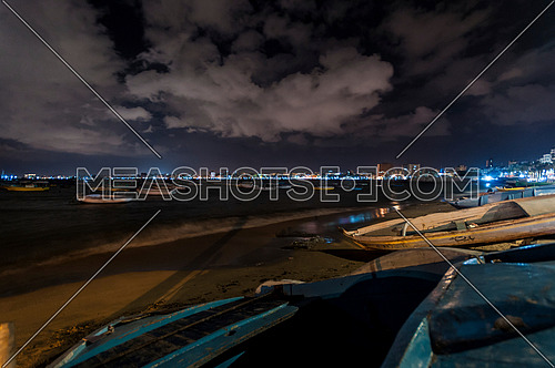 Long shot for sea shore showing fishing boats at alexandria at night