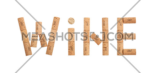 Word WINE shaped by natural wooden wine bottle corks of different vintage years isolated on white background