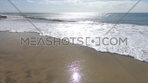 Ocean, Sandy beach and waves