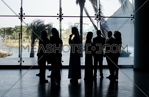 a group of people standing in a business meeting