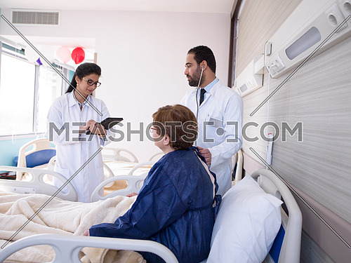 doctor with nurse  and patient at hospital