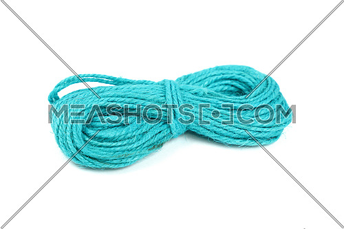 Small coil skein of natural teal blue jute twine rope isolated on white background, close up, high angle view