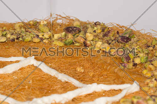 Ramadan Desserts kunafa with cream and honey
