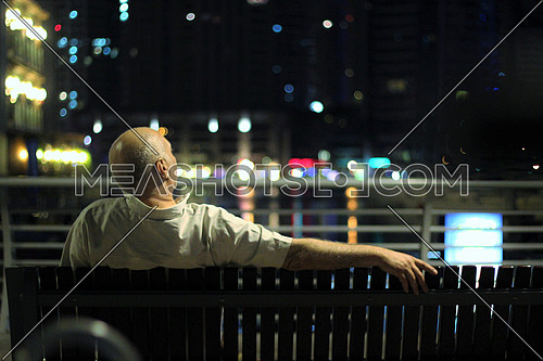 Man sitting on a bench looking forward