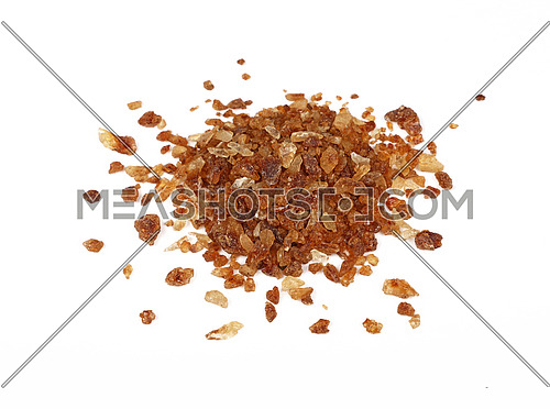 Pinch of big brown caramel candy sugar crystals spilled around isolated on white background, close up, high angle view