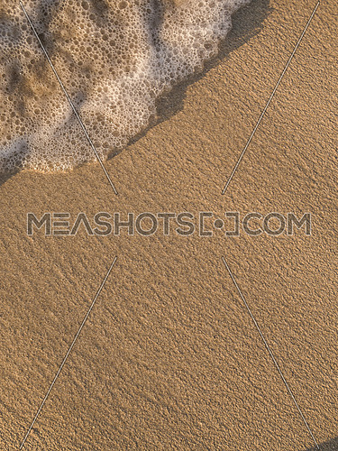 Sea waves breaking on a clean sandy beach