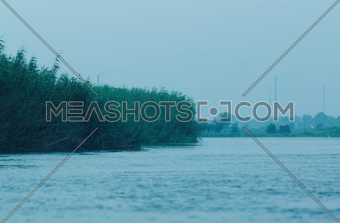 Follow shot for green Island in River Nile